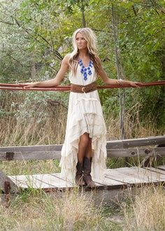 White lace dress with cowgirl boots